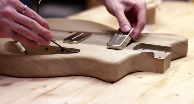 Making a guitar, driling hole in wood body of guitar