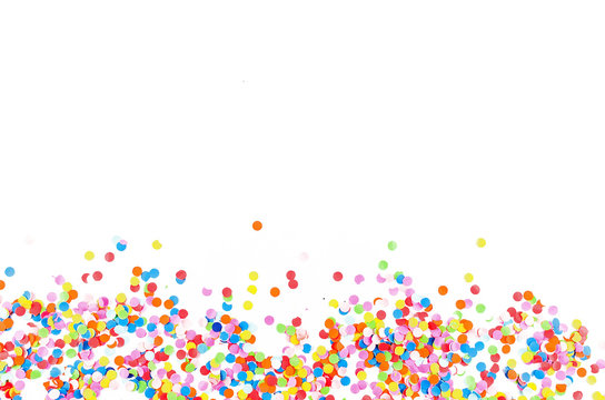 Colorful assorted confetti with serpentine on white