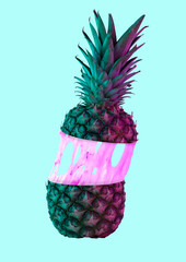 A paradox. An alternative colorful pineapple filled with cream or pink bubblegym against blue...