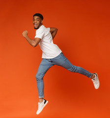 Emotional motivated african-american man running on air