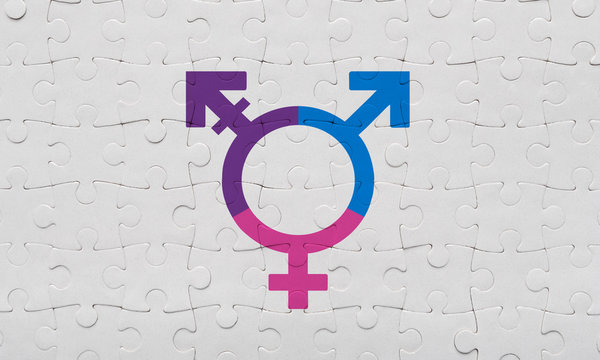 Colorful transgender symbol on white puzzle background