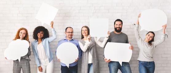 Group of millennial people holding empty speech bubbles