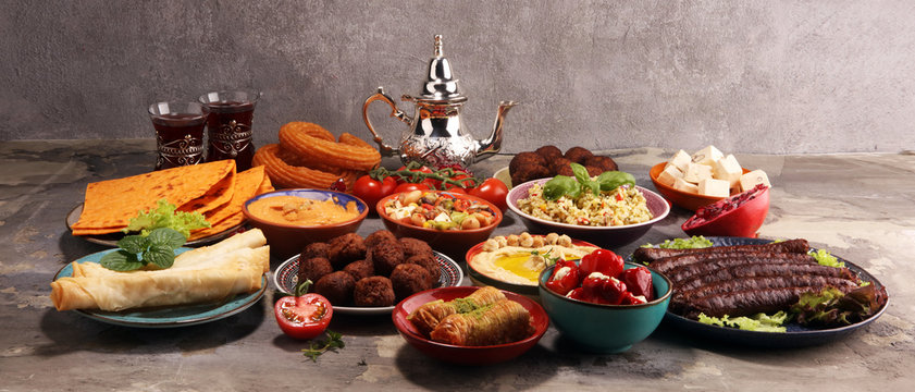 Middle eastern or arabic dishes and assorted meze, concrete rustic background. Falafel. Turkish Dessert Baklava with pistachio. Halal food. Lebanese cuisine