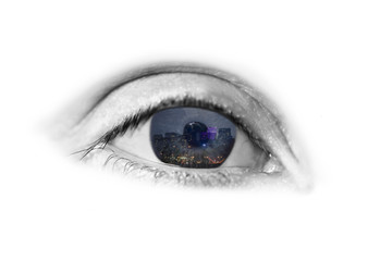 evening city in the beautiful blue eyes of a young girl reflected