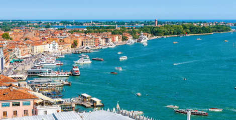 Wall Mural - Venice skyline, Italy. Aerial view of main embankment of Venice. Panorama of Venetian sea port with tourist ships. Cityscape of Venice taken from above. Vacation and travel in Venice in summer.