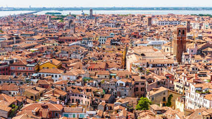 Fototapete - Panorama of Venice taken from above, Italy. Venice skyline in summer. Cityscape of Venice with red tile roofs. Old European town background. Aerial view of the medieval Venice city.