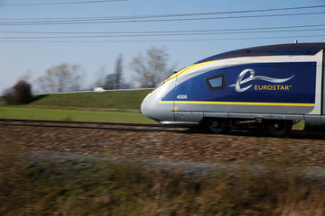 An Eurostar high-speed train speeds on the LGV Nord rail track outside Seclin