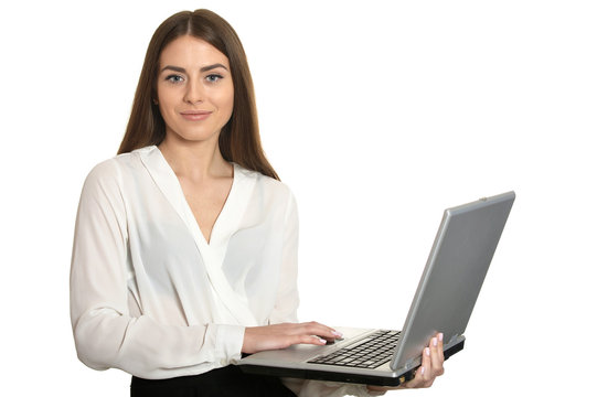 Portrait of young business woman with laptop posing on white background