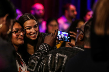 U.S. Representative Alexandria Ocasio-Cortez (D-NY) takes a picture with audiences following a televised town hall event in New York