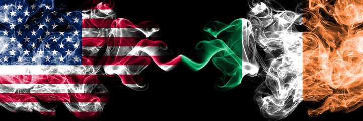 United States of America vs Ireland, Irish smoky mystic flags placed side by side. Thick colored silky smoke flags of America and Ireland, Irish
