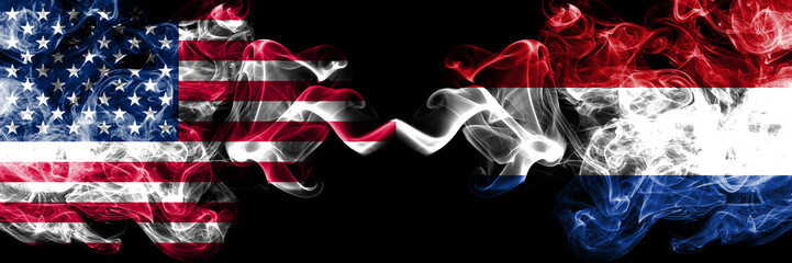 United States of America vs Netherlands, Dutch smoky mystic flags placed side by side. Thick colored silky smoke flags of America and Netherlands, Dutch