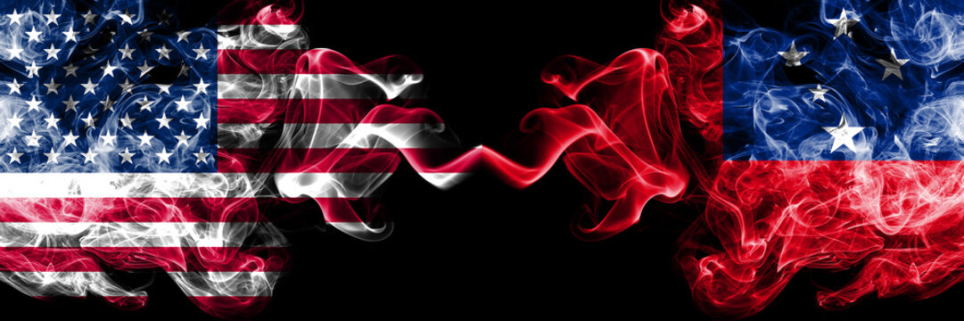 United States of America vs Samoa, Samoan smoky mystic flags placed side by side. Thick colored silky smoke flags of America and Samoa, Samoan