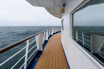 View of foggy day and blue ocean from outside deck of cruise ship, Atlantic Ocean Wall mural