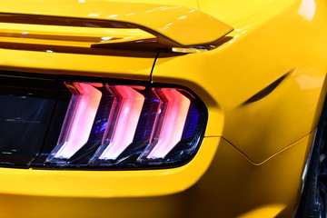 Wall Mural - Close-up view of yellow sports car rear light.