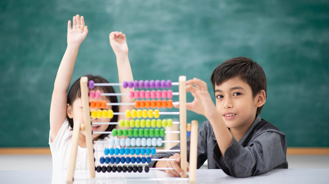 Students boy and girl leaning math in the class room Montessori