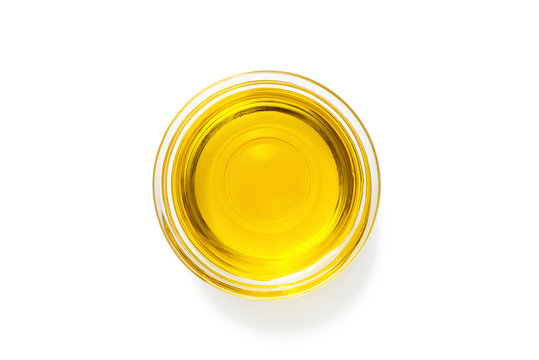 Bowl with olive oil isolated on white.