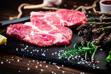 Fresh raw beef steaks on cutting board