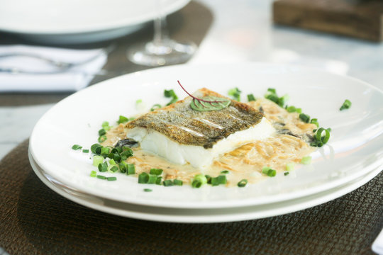 White fish fillet with onion sauce