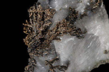 Macro stone mineral silver metal in the rock on a black background