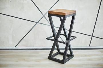 stylish bar chair made of wood and metal.