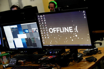 "A computer desktop with wallpaper that reads ""Offline"" is pictured during the Electronic Sports Festival, Austria's largest LAN Party in Vienna"