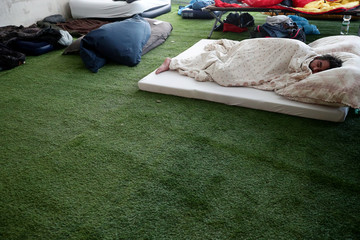 A gamer sleeps in the sleeping area during the Electronic Sports Festival, Austria's largest LAN Party in Vienna