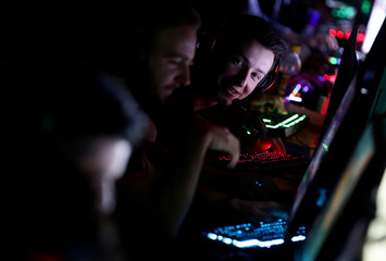 A gamer looks to team members as they take part in a tournament during the Electronic Sports Festival, Austria's largest LAN Party in Vienna