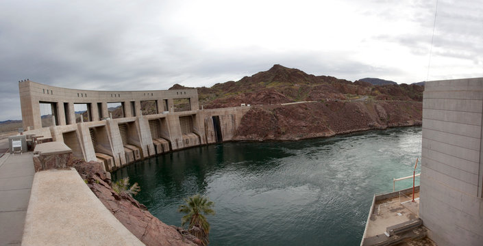 Panorama of Parker dam seen from the California side with the Colorado River in the foreground.