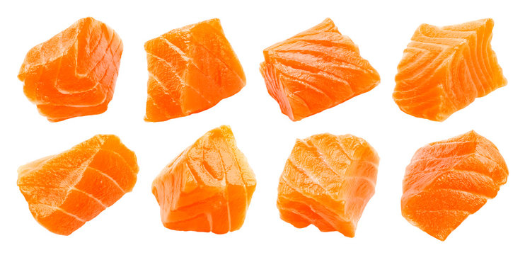 Salmon slices isolated on white background with clipping path, cubes of red fish, ingredient for sushi or salad