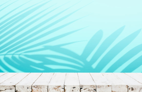 Summer and nature product display with wood table counter on blur coconut leaf background in blue color