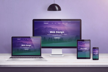 Wall Mural - Flat design web site concept on multiple devices. Work desk with laptop, computer display, smart phone and tablet. Purple wall in bacground.