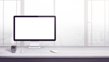 Wall Mural - Modern computer display isolated for mockup on work desk with free space beside for text. Web site design promotion concept.