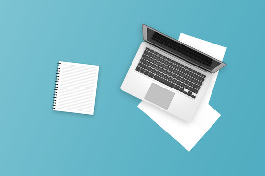 Single Laptop and White Notepad