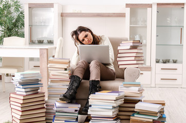 Young female student preparing for exams at home