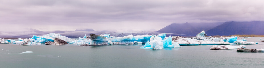 A view of Jokulsalron Glacier in southern Iceland and ice falling to the ocean, Iceland