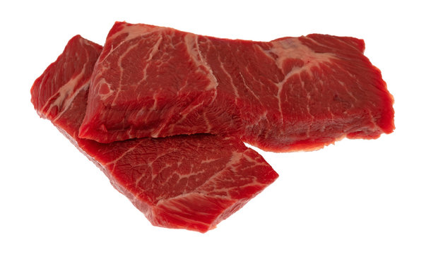 Two slices of beef chuck boneless short rib steak on a white background side view