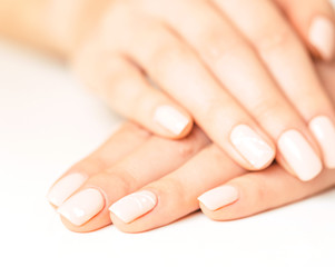Foto op Canvas Manicure Female hands with smooth skin and stylish pink manicure.