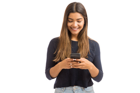 Happy Woman Typing Message On Cell Phone