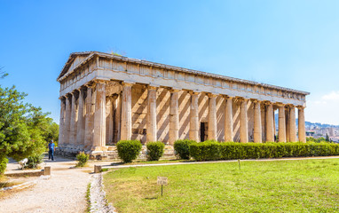 Wall Mural - Temple of Hephaestus in Athens, Greece. It is an old famous landmark of Athens. Sunny view of Ancient Greek ruins in the Athens center. Panorama of the great monument of antique Athens in summer.