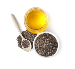 Composition with jar of chia oil and seeds on white background, top view