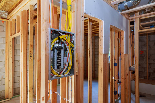Interior wood framing of house under construction power supply for the house