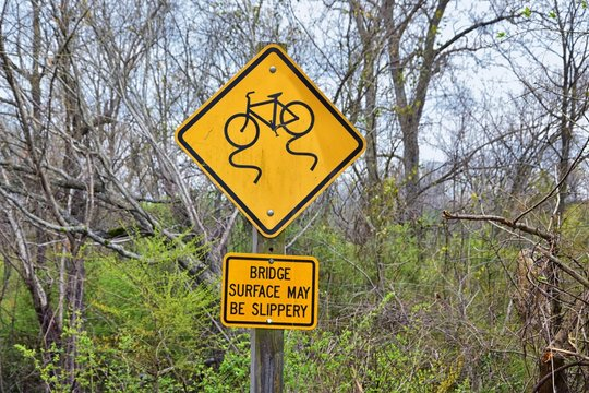 Trail and warning signs along the Shelby Bottoms Greenway and Natural Area Cumberland River frontage trails, Music City Nashville, Tennessee. United States.