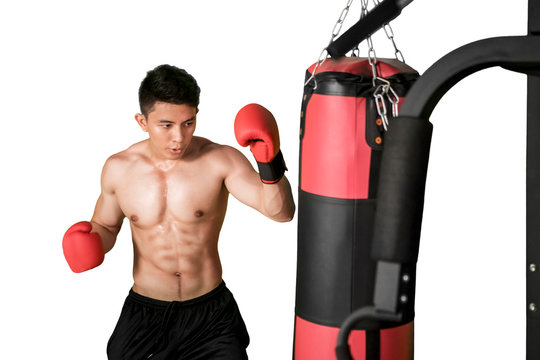 Male athlete is doing boxing exercises on studio