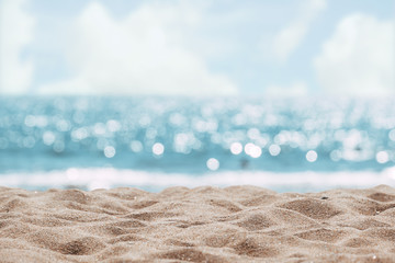 Wall Murals Beach Seascape abstract beach background. blur bokeh light of calm sea and sky. Focus on sand foreground.