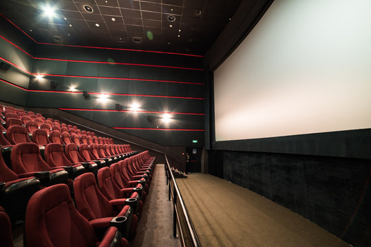 Empty cinema auditorium with screen and seats. Mock Up.