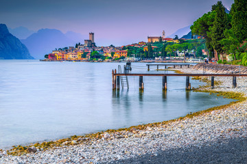 Wall Mural - Malcesine summer tourist resort at colorful sunset, Garda lake, Italy