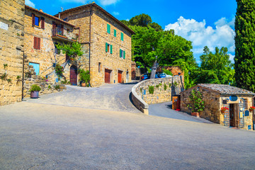 Tuscany street and rustic stone houses decorated with flowers, Monticchiello