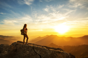 Hiker meets the sunset on the Moro rock in Sequoia national park, California, USA. Wall mural