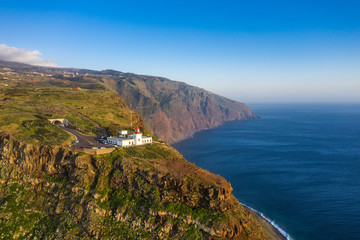 Fototapete - Lighthouse at Ponto do Pargo, Madeira, Portugal. Scenic landscape.