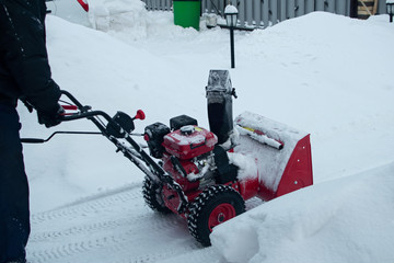 Snow clearing. Snowblower clears the way after heavy snowfall.